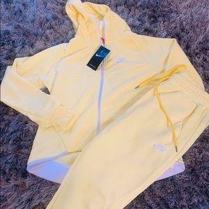 "Nike ""soft yellow"" jumpsuit"